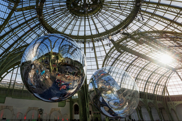 "Tomás Saraceno's ""Aerocene 10.4 & 15.3"" installed at the Grand Palais, in Paris, during the climate change conference in December. Credit via Tanya Bonakdar Gallery; Andersen's Contemporary; Pinksummer contemporary art; Esther Schipper"