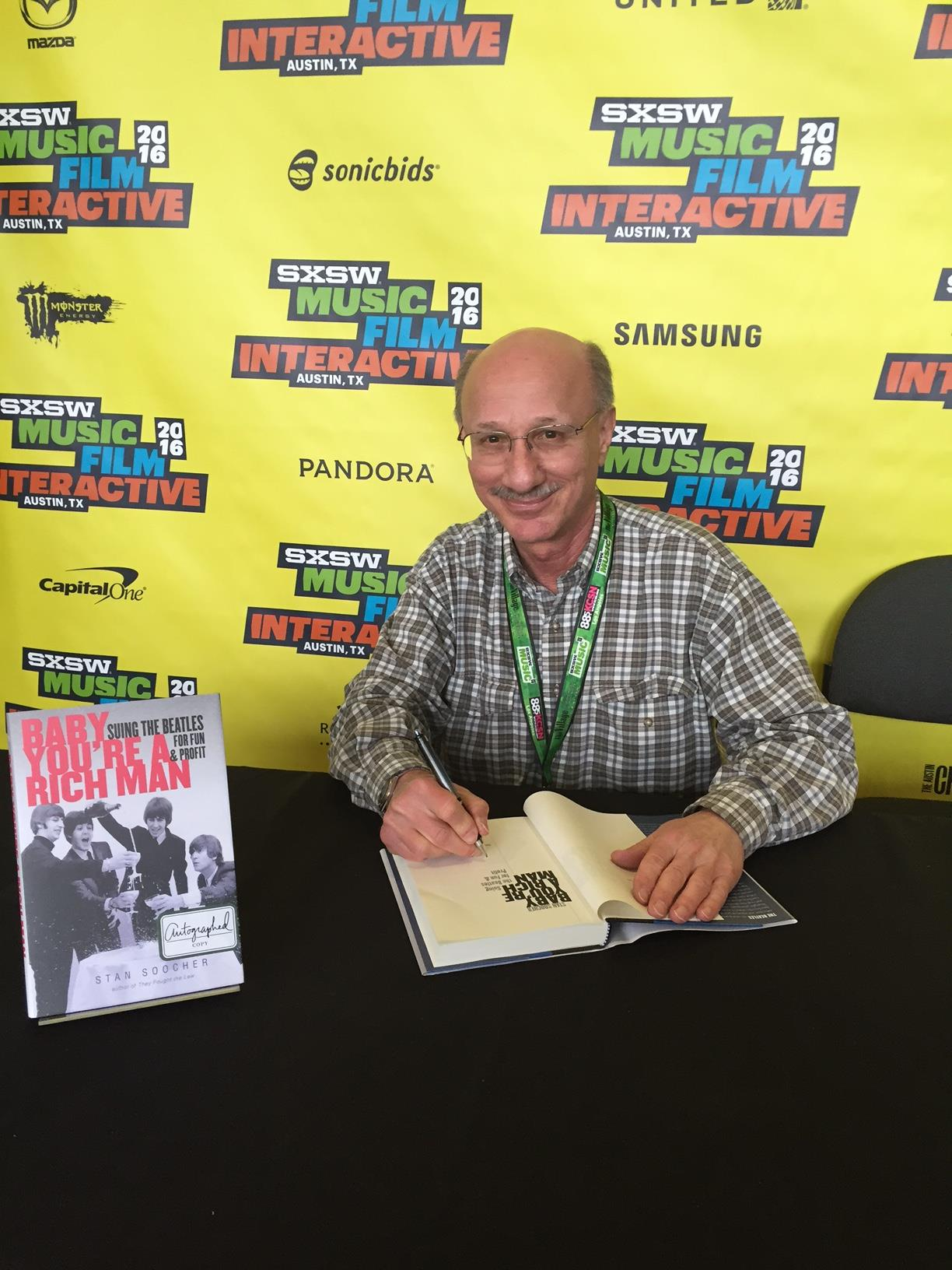 "CAM Professor Stan Soocher signing his book ""Baby You're a Rich Man"" @SXSW"