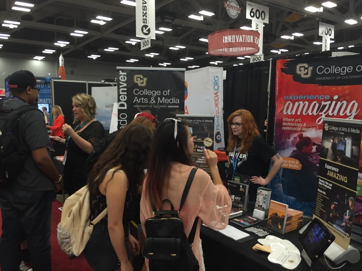 The CAM display booth at SXSW in Austin. 6 students, 2 support staff and 3 faculty.