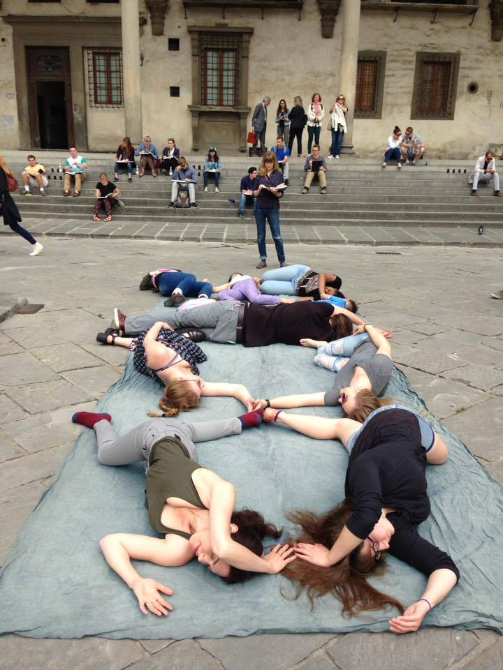University of Colorado Denver photography students creating a cyanotype mural in the Piazza della Santissima Annunziata in Florence, Italy (with many onlookers including tour groups, school children, and other passersby).