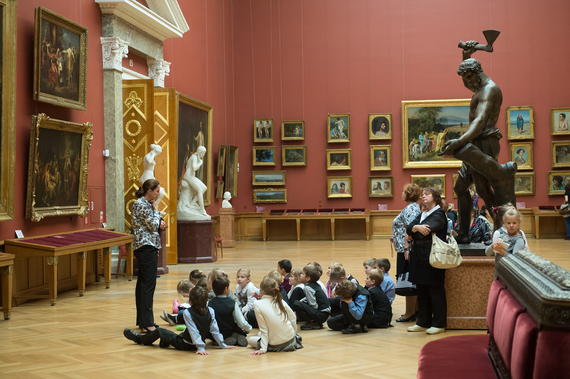 St. Petersburg Russia - September 21 2012: Children on an excursion to Russian Museum considered masterpieces of painting and sculpture listen to the story guide of the works of great artists.