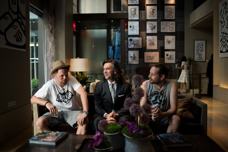 Chaz Barrisson, right, of the street art duo London Police, in the lobby of the Quin Hotel with a former resident artist, Nick Walker, left, and the hotel's art curator, DK Johnston, center. Credit Hilary Swift for The New York Times