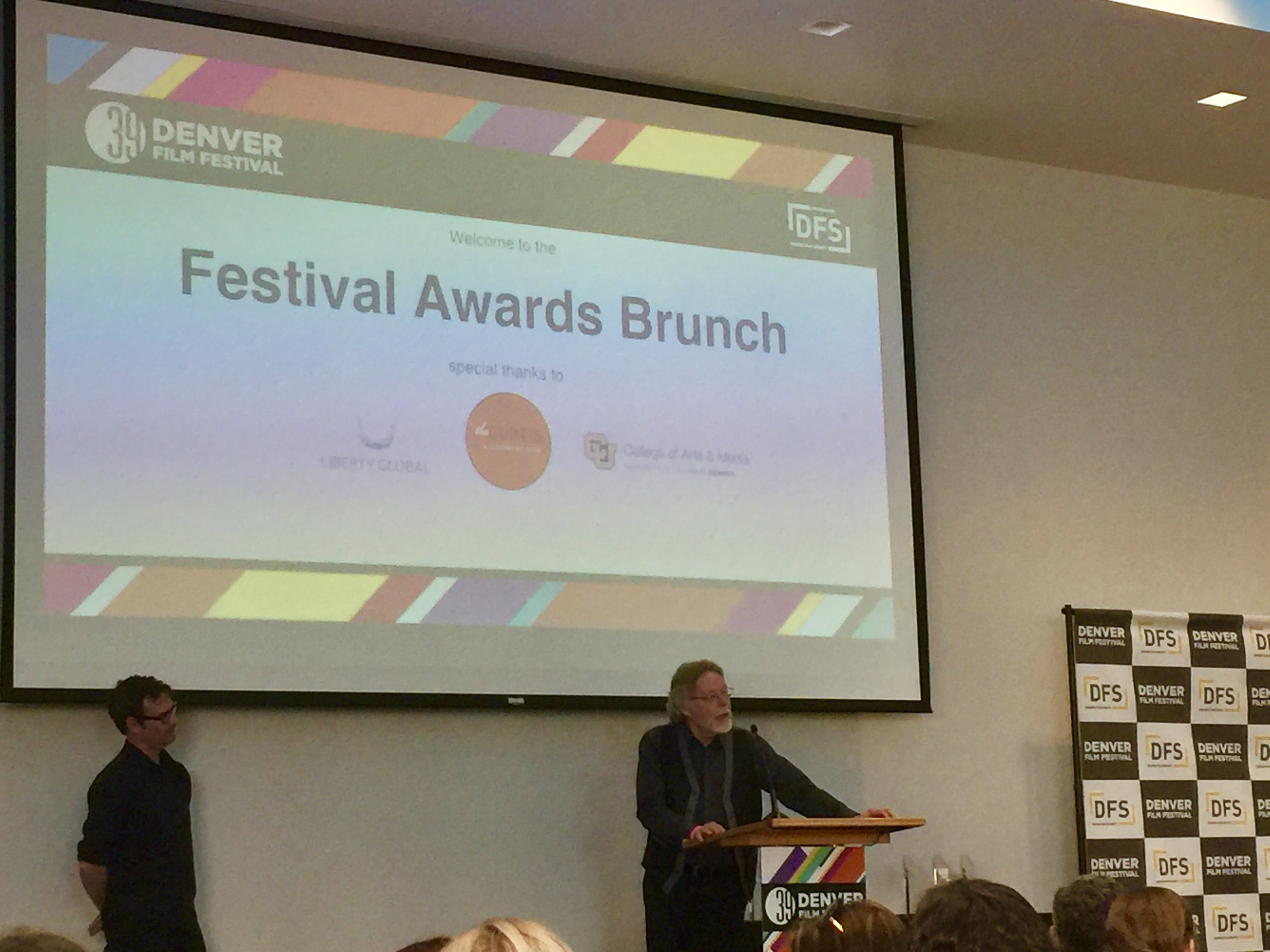 Prof. Craig Volk announcing the winners of the Denver Film Festival Screen Writing Competition.