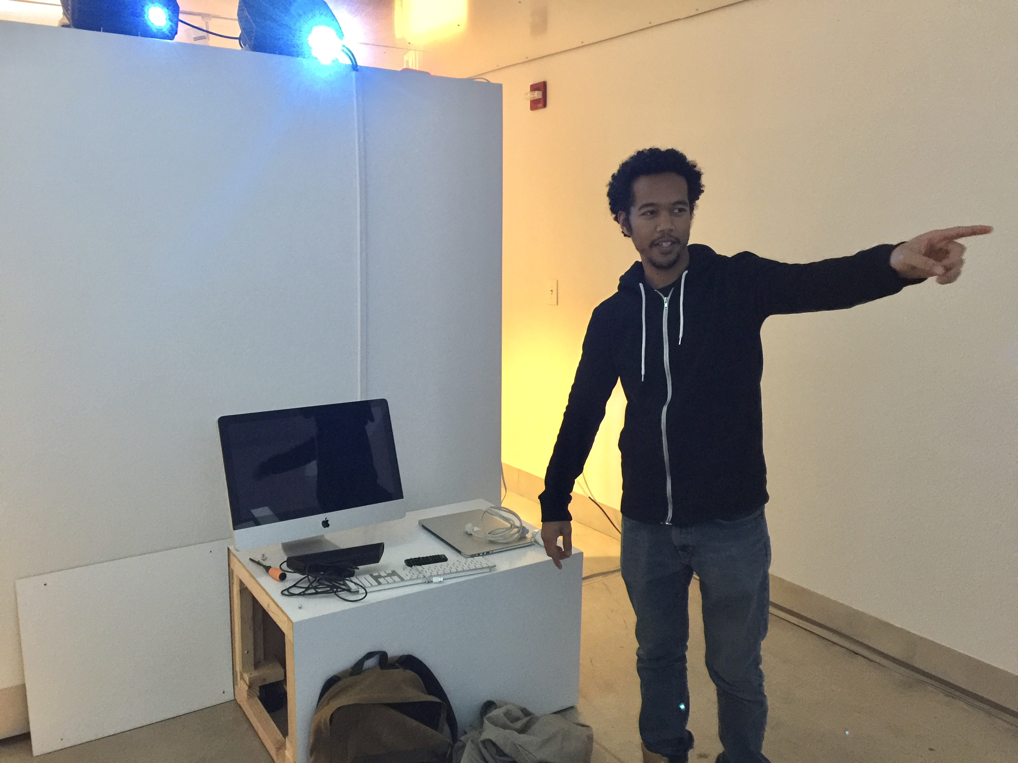 CAM student Robbie Fikes IV explaining an interactive installation he is working on.